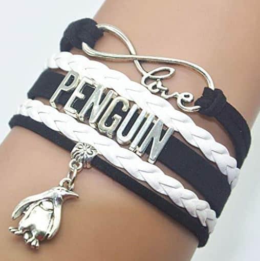 penguin bracelet on a hand